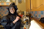 Witch, Halloween party - Paul Box - 2000s,2003,cauldron,female,halloween,hat,hats,ladle,LFL,LIFE,Lifestyle leisure,outfit,party,people,person,persons,pointed,punch,punching,witch,witchcraft,woman,women,YOUNG,YOUNGER,youth