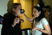 Young women at party drinking - Paul Box - 30-10-2003