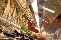 Customer self serves at salad bar Sainsburys supermarket - Paul Box - 01-11-2003