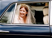 Bride arrives at her wedding ceremony in the wedding car, Essex - Paul Box - 20-06-2002