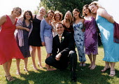 Groom with all the brides female friends at wedding in Essex - Paul Box - 20-06-2002
