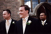 Groom and best man outside the church at wedding in Essex - Paul Box - 20-06-2002