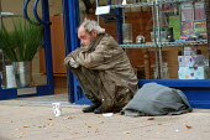 A homeless man in a shop doorway. Clifton Bristol - Paul Box - 10-10-2003