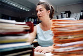 Medical secretary with folders of manual records, Velindre Hospital Cardiff, South Wales - Paul Box - 14-07-2001