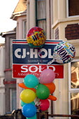 House with sold sign and welcome home balloons - Paul Box - 01-11-2003