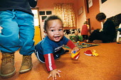 New opportunities fund child care programme. Easton Community Children's centre, Easton , Bristol - Paul Box - ,2000s,2003,appealing,at,BAME,BAMEs,black,BME,bmes,boy,BOYS,CARE,carer,carers,charming,child,Child Care,childcare,CHILD-CARE,CHILDHOOD,CHILDMINDING,children,cities,city,communities,Community,CRECH,cre