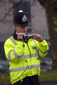 Police officer filming the public at the visit of Tony Blair, Barton Hill, Bristol - Paul Box - 27-11-2003