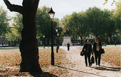 Businessmen walk to the office. Queens Square, Bristol. - Paul Box - 28-11-2003