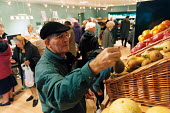 An elderly man shops for fruit and veg at a grocery store. - Paul Box - 01-11-2003