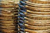 A stack of wicker shopping baskets in a fruit and veg store or a grocery store. - Paul Box - 01-11-2003