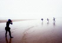 PA photographer Kursty Wigglesworth taking pictures of Kite Surfers Woolcombe Beach Devon. - Paul Box - 14-08-2002