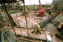 worker with wheelbarrow. Restoration of Whatley Manor, Midas construction site. Malmesbury Witshire - Paul Box - 18-05-2001