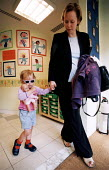 Mother taking child to nursery on the way to work, Bristol. - Paul Box - 14-07-2002