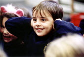 Pupil covering his ears in a lesson at Bruton Primary School Somerset on the senses. - Paul Box - ,2000,2000s,attention,attentive,Auditory,boy,boys,bright,child,CHILDHOOD,children,class,classroom,CLASSROOMS,ear,ears,EDU education,engaged,hearing,intelligence,intelligent,interacting,interaction,int