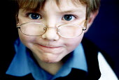 Pupil with glasses in a lesson, Bruton Primary School Somerset on the senses. - Paul Box - ,2000,2000s,appealing,attention,attentive,Auditory,boy,boys,charming,child,CHILDHOOD,children,class,classroom,CLASSROOMS,cute,EDU education,engaged,eyes,eyesight,eyesite,glasses,intelligence,intellige