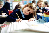 Pupil writing in an English lesson at Bruton Primary School Somerset on the senses. - Paul Box - 2000,2000s,boy,boys,child,CHILDHOOD,children,class,classroom,CLASSROOMS,EDU education,juvenile,juveniles,kid,kids,learning,lesson,LESSONS,male,people,pupil,pupils,School,schoolchild,schoolchildren,SCH