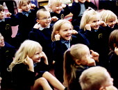 Pupils with their fingers in their ears in a lesson at Bruton Primary School Somerset on the senses. - Paul Box - ,2000,2000s,appealing,attention,attentive,Auditory,boy,boys,bright,charming,child,CHILDHOOD,children,class,classroom,CLASSROOMS,cute,ear,ears,EDU education,engaged,female,females,finger,fingers,girl,g