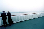 A couple in the early morning mist, onboard ship. - Paul Box - 2000s,2002,adult,adults,and,couple,COUPLES,FEMALE,Getting Married,Heterosexual,Heterosexuals,inlove,LFL,LIFE,Lifestyle,lookin,love,loving,male,man,marriage,marriages,married,MATURE,morning,OCEAN,onboa