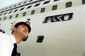 Ships officer on the quayside, P&O cruises Ship Aurora, a 76,000 ton cruiser in dock. It can carry 1800 passengers. Southampton. - Paul Box - 14-05-2002