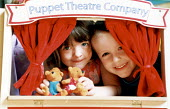 Children playing with a Puppet Theatre. at a playscheme in Gloucestershire - Paul Box - 19-07-2002