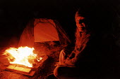 Sitting around the campfire, camping . Pembrokeshire. South Wales. - Paul Box - 2000s,2002,BURN,burning,BURNS,campfire,campfires,camping,EMOTION,EMOTIONAL,EMOTIONS,FEMALE,HAPPINESS,happy,hippies,hippy,holiday,holiday maker,holiday makers,holidaymaker,holidaymakers,HOLIDAYS,LFL li