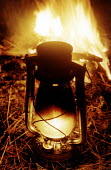 Sitting around the campfire, camping. Tilly lamp. Pembrokeshire. South Wales. - Paul Box - 14-06-2002