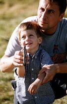 Kite flying Instructor helping a child, Bristol International Kite Festival. - Paul Box - 01-07-2002