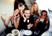 Students enjoying a drink and mobile phone calls at a restaurant in Bristol - Paul Box - 23-11-2001