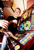 Students enjoying a pint at the Pub and playing electronic games machines in Bristol. - Paul Box - 23-11-2001