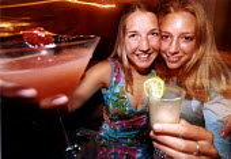 Women enjoying a cocktails at a bar in Bristol - Paul Box - 23-11-2001