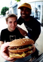 University students with beefburger. McDonalds - Paul Box - 14-05-2002