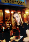 Student working as a waitress serving drinks at a cafe bar, Boon Bar Bristol. - Paul Box - 2000s,2002,Alcohol,cafe,cafes,catering,cities,city,drink,drinking,EARNINGS,EBF economy,EDU education,employee,employees,Employment,EQUALITY,europeregi,higher education,Hospitality,Income,INCOMES,inequ