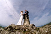 Bride and groom at a wedding, Dinas Head, Wales. - Paul Box - 14-07-2002