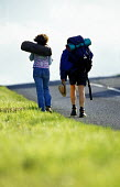 Students hitch hiking to Glastonbury Festival. - Paul Box - 2000s,2001,a,AUTO,AUTOMOBILE,AUTOMOBILES,AUTOMOTIVE,car,cars,FEMALE,festival,FESTIVALS,goer,hiker,hikers,hiking,hitch,hitching,holiday,holiday maker,holiday makers,holidaymaker,holidaymakers,HOLIDAYS,