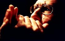 Musician playing the mouth organ. - Paul Box - 14-06-2002