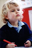 Pupil looking and listening in a lesson at Bruton Primary School Somerset - Paul Box - ,2000,2000s,appealing,attention,attentive,bright,charming,child,CHILDHOOD,children,class,classroom,CLASSROOMS,CONCENTRATE,concentrating,cute,diligent,EDU education,engaged,intelligence,intelligent,int