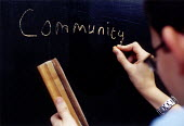 Teacher writing on the blackboard - Community - in a lesson at Bruton Primary School Somerset - Paul Box - 14-07-2000
