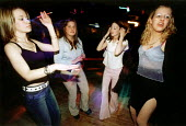 Young teenagers dancing at a disco, Weston Super Mare. - Paul Box - 14-03-2002