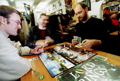Shop owner of a games shop, playing a Lord of the Rings board game at a games club. Bristol. - Paul Box - 14-10-2002