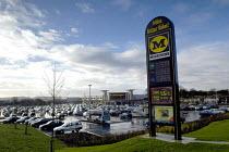 Morrisons supermarket , Cribbs Causeway, Bristol. - Paul Box - 2000s,2004,AUTO,AUTOMOBILE,AUTOMOBILES,AUTOMOTIVE,bought,buy,buyer,buyers,buying,car,car park,car parks,cars,cities,city,commodities,commodity,communicating,communication,consumer,consumers,customer,c