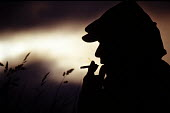 Silhouette of a man smoking a joint - Paul Box - 18-01-2004