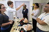 Anaesthetists training other medics (including doctors,nurses gps and anaesthetists) in difficult airway management. At the Bristol Medical Simulation Centre, Bristol. The BMSC is the first centre of... - Paul Box - 2010s,2013,airway,anaesthesia,anaesthetic,Anesthesia,anesthetic,BAME,BAMEs,Black,BME,bmes,care,cities,city,computer controlled,diversity,doctors,dummies,dummy,employee,employees,Employment,ethnic,ethn