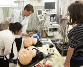 Anaesthetists training other medics (including doctors,nurses gps and anaesthetists) in difficult airway management. At the Bristol Medical Simulation Centre, Bristol. The BMSC is the first centre of... - Paul Box - 2010s,2013,airway,anaesthesia,anaesthetic,Anesthesia,anesthetic,BAME,BAMEs,BME,bmes,care,cities,city,computer controlled,diversity,doctors,dummies,dummy,employee,employees,Employment,ethnic,ethnicity,