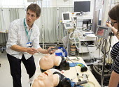Anaesthetists training other medics (including doctors,nurses gps and anaesthetists) in difficult airway management. At the Bristol Medical Simulation Centre, Bristol. The BMSC is the first centre of... - Paul Box - 2010s,2013,airway,anaesthesia,anaesthetic,Anesthesia,anesthetic,care,cities,city,computer controlled,doctors,dummies,dummy,employee,employees,Employment,hea,health,HEALTH SERVICES,Health Worker,Health