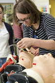 Anaesthetists training other medics (including doctors, nurses gps and anaesthetists) in difficult airway management. At the Bristol Medical Simulation Centre, Bristol. The BMSC is the first centre of... - Paul Box - 2010s,2013,airway,anaesthesia,anaesthetic,anaesthetist,Anesthesia,anesthetic,care,cities,city,computer controlled,doctors,dummies,dummy,employee,employees,Employment,female,hea,health,HEALTH SERVICES,