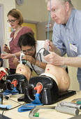 Anaesthetists training other medics (including doctors,nurses gps and anaesthetists) in difficult airway management. At the Bristol Medical Simulation Centre, Bristol. The BMSC is the first centre of... - Paul Box - 2010s,2013,airway,anaesthesia,anaesthetic,Anesthesia,anesthetic,BAME,BAMEs,Black,BME,bmes,camera,cameras,care,cities,city,computer controlled,diversity,doctors,dummies,dummy,employee,employees,Employm