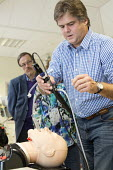 Anaesthetists training other medics (including doctors,nurses gps and anaesthetists) in difficult airway management. At the Bristol Medical Simulation Centre, Bristol. The BMSC is the first centre of... - Paul Box - 16-10-2013