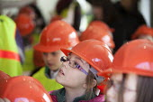 School pupils visiting Charlton Hayes, a new housing development by David Wilson and Barratt Homes, Bristol - Paul Box - 2010s,2013,builder,builders,building,building site,BUILDINGS,child,CHILDHOOD,children,cities,city,Construction Industry,development,edu,educate,educating,education,educational,female,females,girl,girl