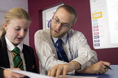 A teacher helps a pupil studying at Clevedon school, Clevedon. - Paul Box - 10-09-2013