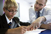 A teacher helps a pupil studying at Clevedon school, Clevedon. - Paul Box - 23-09-2013